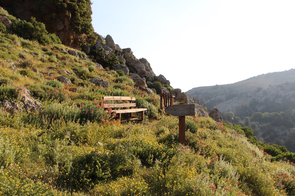 Bench and sign on the way to the top of Mount Psoriaris
